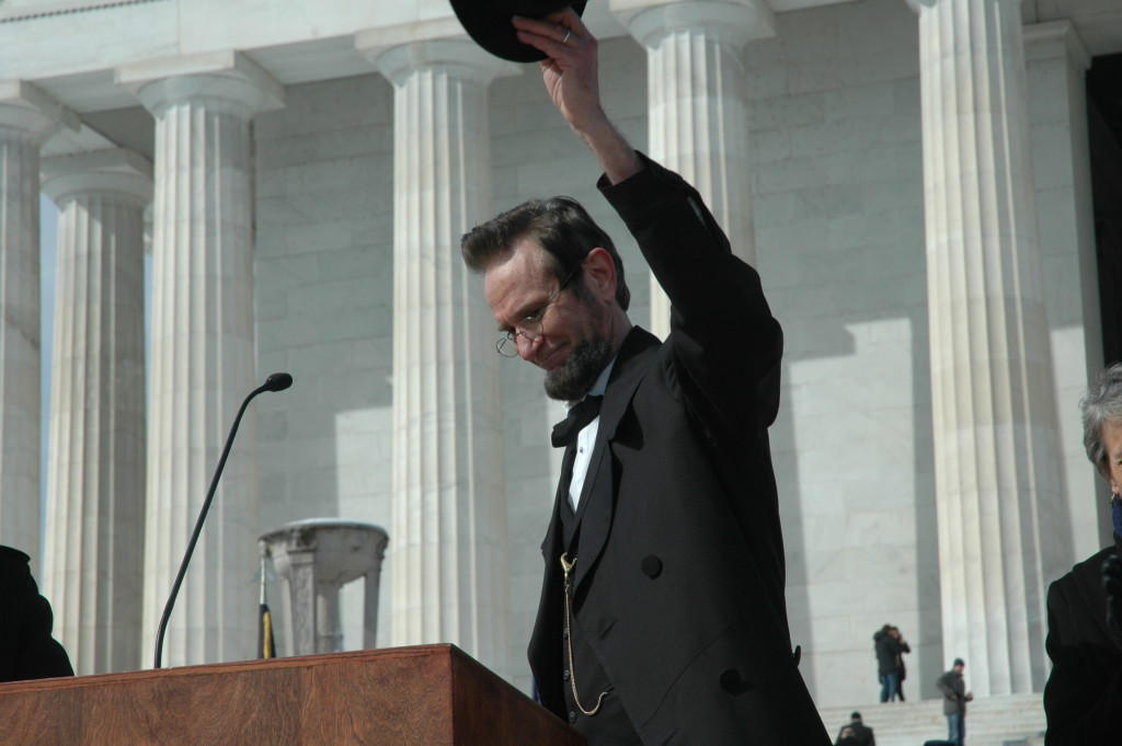 Lincoln raising hat